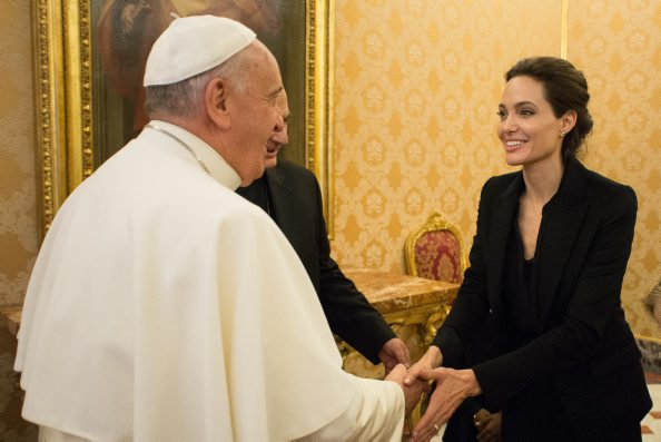 This handout picture released on January 8, 2015 by the Vatican press office shows Pope Francis meeting with US actress and UNHCR ambassador Angelina Jolie at the Vatican. Pope Francis will reportedly attend a screening of Angelina Jolie's film, Unbroken. The film focuses on the real-life story of Louis Zamperini, an American athlete who met Hitler at the 1936 Olympics before being drafted into the Second World War after the Pearl Harbour bombing./AFP PHOTO