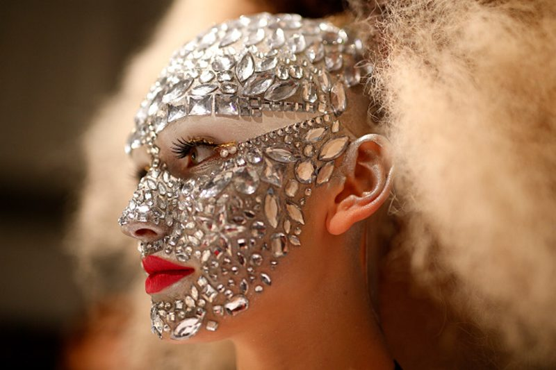A jewellery masked model is seen backstage ahead of the It's Showtime - Maybelline New York 100th Anniversary show during the Mercedes-Benz Fashion Week Berlin in Berlin, Germany.  (Joern Pollex/Getty Images for IMG)