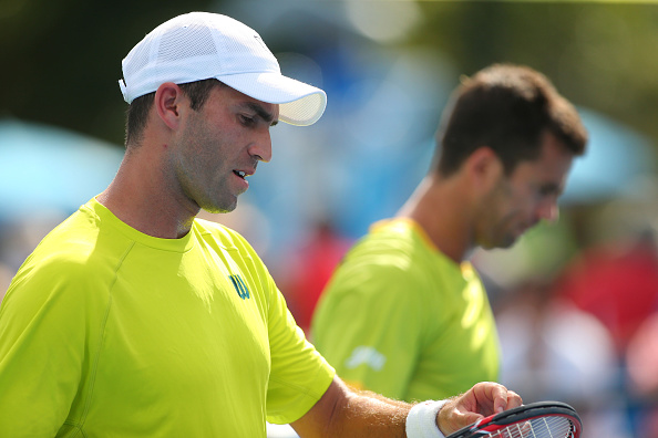 Horia Tecau of Romania and Jean-Julien Rojer of the Netherlands talk tactics in their first round doubles match against Ricardas Berankis of Lithuania and Andreas Haider-Maurer of Austria during day four of the 2015 Australian Open at Melbourne Park on January 22, 2015 in Melbourne, Australia.  (Patrick Scala/Getty Images)
