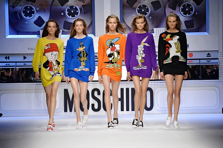 Models walk the runway at the Moschino Autumn Winter 2015 fashion show during Milan Fashion Week. (Getty Images)